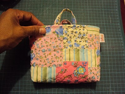 small organizer bag with lots of pockets