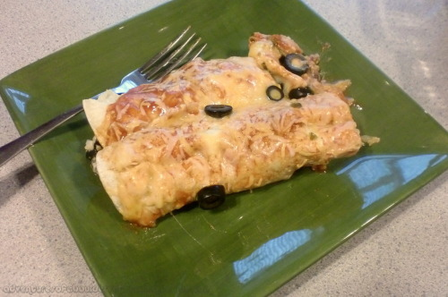 Spicy Black Bean and Sour Cream Enchiladas [I really like Mexican food, have you noticed? I also get bored really easily. I have a go-to enchilada recipe that is glorious, but sometimes I just need to switch it up a little bit. Or, in this case, a lot bit (that's a saying, right?) The combination of the cinnamon and the lime is really what makes these babies amazing, for me.] Ingredients: Approximately 14 small corn tortillas 2 cans of black beans 2 cloves of garlic, minced 1 bunch of cilantro, chopped 1 small/medium yellow onion, finely chopped 1/4 cup pickled jalapenos (you could also use green chiles here) 2 cans of sliced black olives, drained 1 can red enchilada sauce 1/2 cup sour cream 1 cup shredded cheese (I used a Mexican blend, but use whatever cheese suits your fancy) Zest and juice of 1 lime 1 teaspoon of cumin 1 teaspoon of chili powder 1/2 teaspoon of cinnamon Directions: Heat the oven to 350 degrees.  In a large bowl, combine the beans, garlic, onion, cilantro, jalapenos, and olives. Add in the lime zest and juice, spices, and 1/3 of a cup of the cheese. Stir until everything is well combined. Spoon a good amount of filling onto a tortilla. Roll the tortilla as tight as you can (this is a lot harder than it seems. Just do the best you can, it's not the end of the world if the tortillas roll open.) Place the rolled tortilla in a 9x13inch pan. Repeat the process until all of the filling is gone. Pour the enchilada sauce evenly over all of the filled tortillas. Sprinkle on the rest of the cheese. Bake for 15-20 minutes, until the cheese is nice and melty. Serve and enjoy! <3