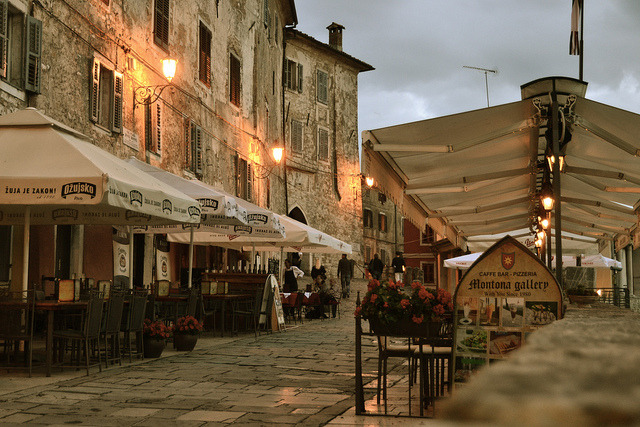 ysvoice:   | ♕ |  Gateway cafe at dusk - Motovun, Croatia  | by © flitshans UNESCO World Heritage Site  |  The City of Motovun is located in central Istria of Croatia, on the hillside, looking over the Mirna River Valley. It was developed on the Prehistoric citadel site. During the middle Ages it changed various feudal masters and kept its city autonomy. In the period between 1278-1797, it was continuously under the Venetian rule.