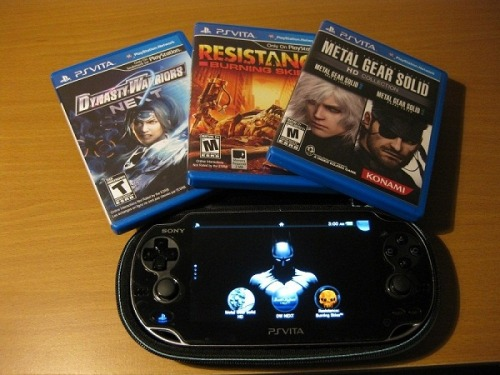 •Newest edition to my arsenal of games! PS Vita (W/Sick Batman Backround)