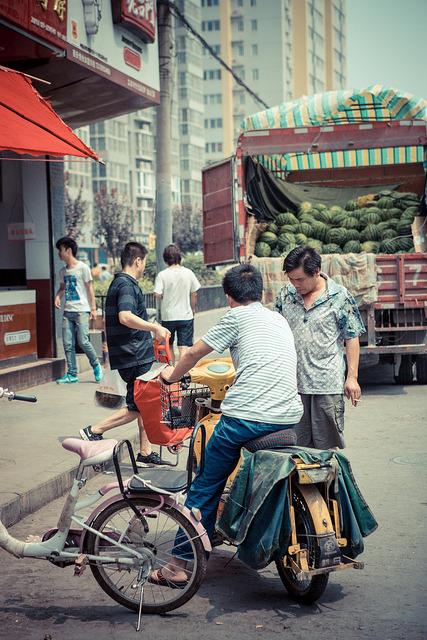 "1267 on Flickr. Via Flickr:xian, shaanxi, china two men: friends, co-workers, or strangers? chatting, negotiating, or merely glancing? parting ways or meeting to carpool (bike-pool)? a daily occurrence or a random interaction? i'm growing fond of street photography, but of course after the post-processing is done, there's still a sense of unresolved business. who are the people i'm taking pictures of, really? what are their stories? is the moment i captured something habitual or sporadic; is it an accurate representation of ""street photography"" or are wrong implications forced upon my photos simply based on my eye's bias? i could stop and ask them, theoretically…but then something else is lost in pose. perhaps there's never a happy medium, but perhaps that truth is the happy medium in itself? guess we'll never know for sure:)"