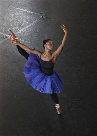 "'Brilliance is colorblind': Star dancer born in war-torn Sierra Leone grows up to inspire   'Because I've been through so much, I know now that I can make it and I can help other kids … realize that they can make it too'   Michaela DePrince was little more than a toddler when she saw her first ballerina — an image in a magazine page blown against the gate of the orphanage where she ended up during Sierra Leone's civil war. It showed an American ballet dancer posed on tip toe.    ""All I remember is she looked really, really happy,"" Michaela told The Associated Press this week. She wished ""to become this exact person.""    From the misery of the orphanage ""I saw hope in it. And I ripped the page out and I stuck it in my underwear because I didn't have any place to put it.""    Now Michaela's the one inspiring young Africans: She escaped war and suffers a skin pigmentation disorder that had her labeled ""the devil's child"" at the orphanage. She's an African dancer in the world of ballet that sees few leading black females. She was adopted and raised to become a ballerina in the U.S. — a country where she believed everyone walked around on tippy toes.    Read more here http://www.msnbc.msn.com/id/48158581/ns/world_news-africa/"