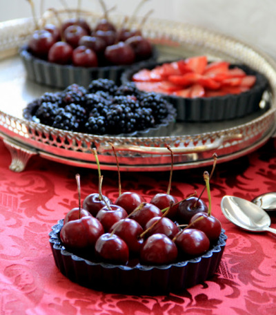 foodfuckery:  Chocolate Pies with diverse fruit on top: Cherries, Strawberries and Blackberries Recipe