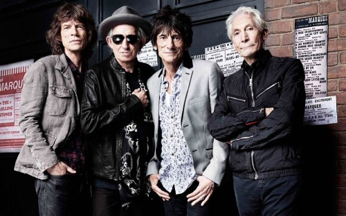 ROLLING, STILL   Mick Jagger, Keith Richards, Ronnie Wood and Charlie Watts pose in front of a mock-up of the Marquee Club to mark the 50th anniversary of the Rolling Stones's first ever live performance at the venue on London's Oxford Street on July 12, 1962.  (Photo: Rankin / Reuters via The Telegraph)