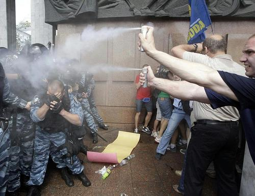 thesochillnetwork:  In Soviet Russia protestors pepper spray you!