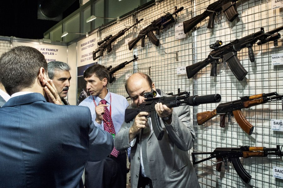 The head of the Syrian delegation to the arms bazaar tries out a new silencer-equipped Kalashnikov assault rifle. TIME contract photographer Yuri Kozyrev's look inside the Russian weapons bazaar that is powering Syria's regime. See more photos here.