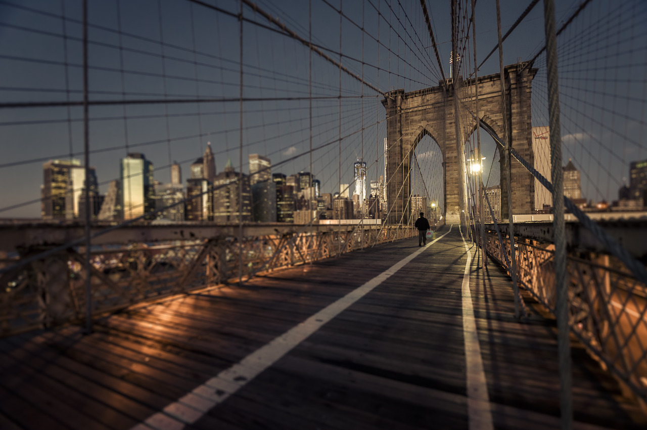 Quiet walk on the Brooklyn Bridge at dawn