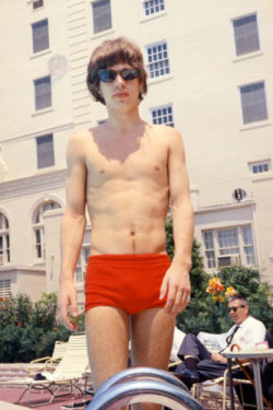 Nice shorts ^_^  sanguinesharpness:  guardian:  The stones started their first US tour in 1964. Here Mick Jagger struts around poolside at the Jack Fort Harrison Hotel, Clearwater, Florida   Photograph: Bob Bonis, 2269 Productions Inc/WENN.com