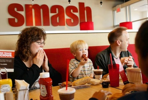 Watch out, In-N-Out: Smashburger has arrived. The Denver chain, regarded by Forbes as the most promising company in the U.S., brings its so-called better burgers to Thousand Oaks. It plans to open as many as 60 outlets in the region. Photo: Smashburger, which launched in 2007, now has 163 restaurants. Above, Heather Hoy, left, her son Andrew, 2, and her husband, Blair, dine at one in Elmhurst, Ill. (Keri Wiginton / MCT