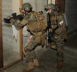 ofspacifica:  Marines with the Maritime Raid Force enter and secure rooms against armed aggressors  by #PACOM on Flickr.Via Flickr: COMBINED ARMS TRAINING CENTER CAMP FUJI, Japan   (Jul. 9, 2012) -  Marines with the Maritime Raid Force, 31st Marine Expeditionary Unit, enter and secure rooms against armed aggressors during a raid.  The raid was part of the Realistic Urban Training Exercise, evaluated by Special Operations Training Group. It is designed to integrate unique individual and small unit skills in order to increase the proficiency for the 31st MEU's rapid response planning process in a challenging and unfamiliar environment. (Photo by Lance Cpl. Michael Oxton) ** Interested in following U.S. Pacific Command?  Engage and connect with us at www.facebook.com/pacific.command and twitter.com/PacificCommand and www.pacom.mil/