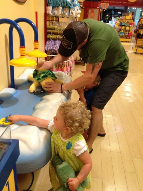 Chris helping his kids at Build-a-bear