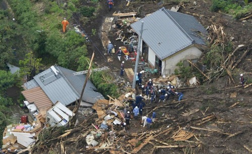 Flash floods in Japan leave trail of destruction NBC News:  An unprecedented 20 inches of rain descended on the town of Aso in southwestern Japan, inundating homes and rice paddies and killing at least 6 people. 20 people are still reportedly missing. Images on local news reports showed cars being dragged into the raging rivers and houses destroyed by landslides. But by around noon time the rain had stopped, allowing for the clean up efforts to begin.  Photo: An aerial view shows firefighters searching among collapsed houses following a landslide caused by heavy rains in Minamiaso town on July 12, 2012. (Kyodo via Reuters)