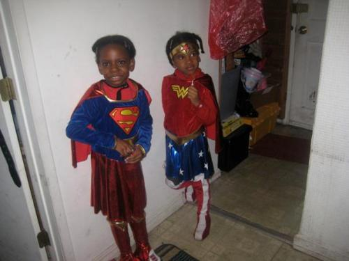 girlslovesuperheroes:  This is from Halloween 2011. My daughters are Super Girl and Wonder Woman. My oldest daughter also went with me to the opening of the Avengers. They love super heroes.  I think the biggest break-through in destroying misogyny among geeks, is that there are an awful lot of geek parents out there who think it is totally awesome when their daughters are into geeky things. Right on.