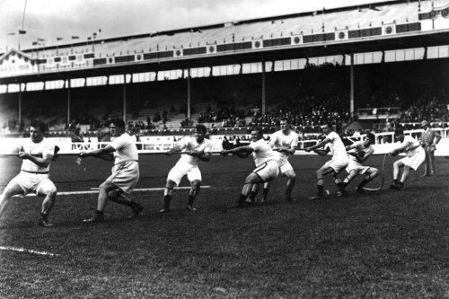 collective-history:  USA men's tug of war team, 1908 Olympics in London.