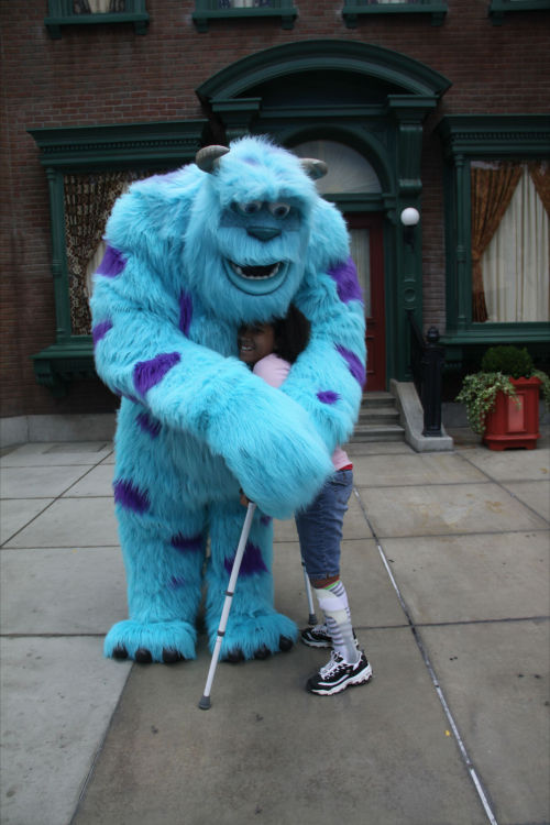 Here's Tessa on her wish trip to Disneyland giving Sully from Monsters, Inc. a big hug!