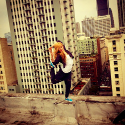 dancing on the rooftop of a 10 story building at her photoshoot for her new clothes