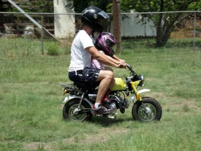 Dylan Hoey and his daughter Lux riding her new mini motorcycle. A motolady in the making!