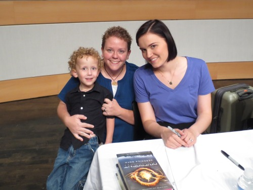 I took my son Tobias to meet Veronica Roth at the Salt Lake City Library last night.  It was pretty awesome.  She's even more beautiful in person, and it was really neat to meet her.  I can't wait till my Tobias is old enough to read Divergent - I had her sign my copies to him :-)