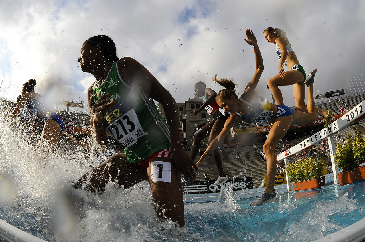 Athletes attempt to clear the water jump during the Women's 3000 metre Steeplechase Final on the day three of the 14th IAAF World Junior Championships in Barcelona, Spain.  (Photo by David Ramos/Getty Images)
