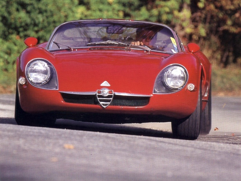 definemotorsports:  Alfa Romeo Tipo 33 Stradale '1967–69 If I think that one of these pornographically illegal sexy machine was driving around in my town and I missed it it makes me wanna cry in a corner. (Funny fact is that I have Alfa's official museum in my very town, but it's closed, duh)