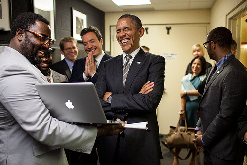 Obama and cast of Late Night With Jimmy Fallon watching live feed of Romney's NAACP National Convention speech.