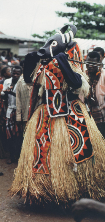 Mma masquerade performed by residents of Amuvi village at the Amaikpe communal village group square on Eke Ekpe day of Ikeji, September 24, 1988. This mask represents a bush cow (Atu Ejeogwu). Mma is typical of the north eastern part of Igboland and the neighboring Idoma people. The Arochukwu village of Amuvi has settlements in that area. Amuvi people adopted Mma masquerade. As many Aro settlers in that area were displaced during the Nigerian Civil War, they brought Mma with them when they returned to Arochukwu. Photo: Eli Bentor.  — Eli Bentor via ukpuru