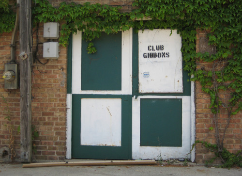 The painted alley doors of Club Gibbons on Chicago's Northwest Side. Photographed earlier today.