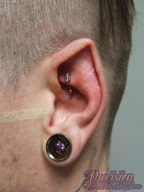 nathansummers:  ryanpba:  Fancy ear! New rook with Industrial Strength channel set curved barbell, amethyst in copper. Piercing by Ryan Ouellette, Precision Body Arts in Nashua, NH. Lobe with Anatometal polaris eyelet. Ear pointing by Samppa Von Cyborg.   Ryan pierced my rook today. Fancy ear go