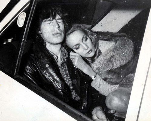 streetsofcalcutta:  me on a friday night loljk  Jerry Hall looking like an Old Hollywood starlet; Mick Jagger looking like he's having an injection and trying not to think about it.