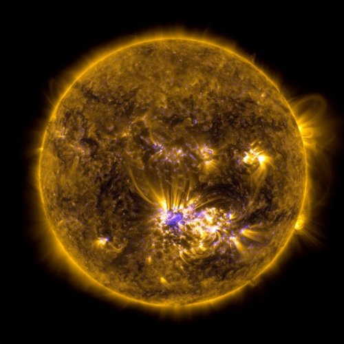 The Coronal Mass Ejection associated with this X1-class flare is of Type O and traveling at approx. 1,400 km/s. While it is Earth directed, no major impact is expected. This image combines two sets of observations of the sun at 10:45 AM EDT, July 12, 2012 from the Solar Dynamics Observatory (SDO) to give an impression of what the sun looked like shortly before it unleashed an X-class flare beginning at 12:11 PM EDT. The image incorporates light in the 171 Angstrom wavelength, which shows off giant loops of solar material overlying the middle of the sun over Active Region 1520 where the flare originated. The second set of observations is called a magnetogram, which highlights magnetic fields on the sun. Together these kinds of observations can help scientists understand the magnetic properties of the sun that lead to giant explosions like flares. Credit: NASA SDO