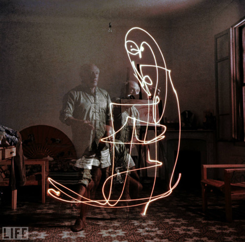 Picasso drawing with fire.