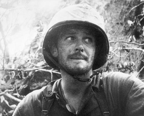 "erfurt1918:  A Marine after several days of hard fighting on Peleliu 1944.This picture goes to show how brutal the Pacific Campaign of World War II was.  The look of complete and utter fear in this man's eyes is terrifying and heart-breaking. ""To the non-combatants and those on the periphery of action, the war meant only boredom or occasional excitement, but to those who entered the meat grinder itself the war was a netherworld of horror from which escape seemed less and less likely as casualties mounted and the fighting dragged on and on. Time had no meaning, life had no meaning. The fierce struggle for survival in the abyss of Peleliu had eroded the veneer of civilization and made savages of us all."" -Eugene B. Sledge, With the Old Breed: At Peleliu and Okinawa"