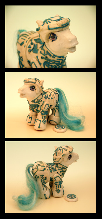 savethewailes:  My Little Tron!Made with sculpey, resin, and acrylics over an existing pony. also on my deviantart: http://eattoast.deviantart.com/art/My-Little-Tron-314353249