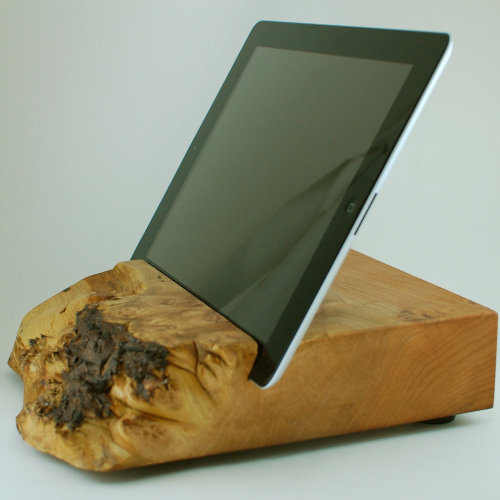 lucasthegeek:  Block and Sons Co. makes high-quality iPad stands out of Oregonian wood. You can buy them here: http://blockandsons.com/index.html. Supply is limited.