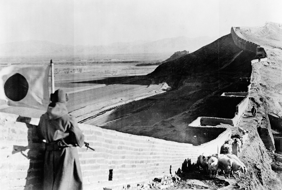 A Japanese soldier stands guard over part of the captured Great Wall of China in 1937 during the Second Sino-Japanese War