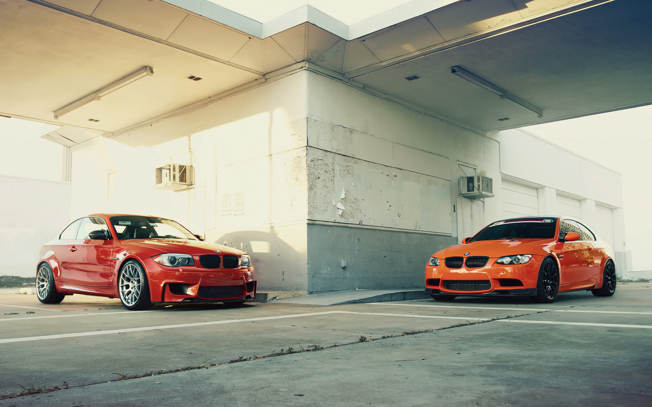 bimmers:  BMW 1M Coupe vs. BMW M3.Valencia Orange vs. Fire Orange. More BMW photos at Bimmers.tumblr.com