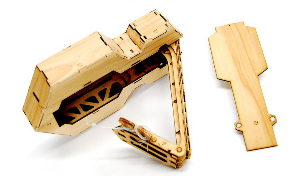 Brian Chan wins the Core 77 DIY award for this ingenious laser cut folding ukulele design!