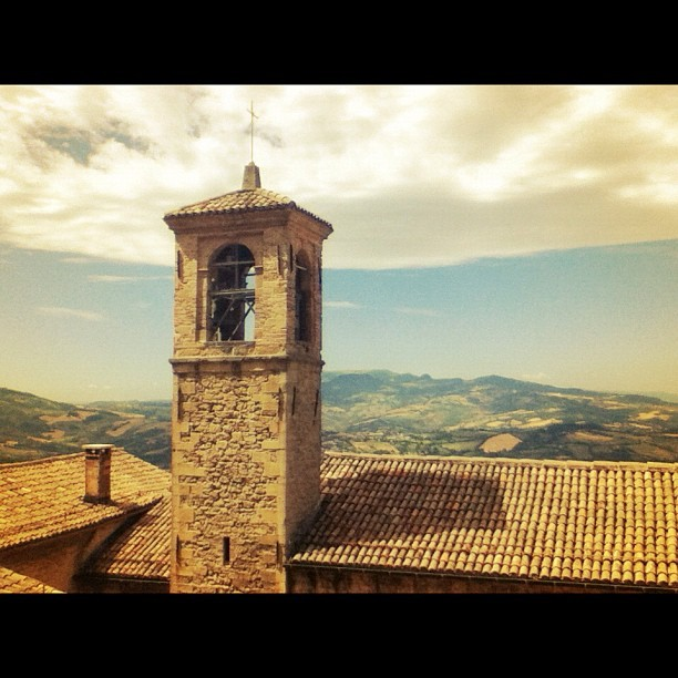 Bell tower in San Marino with Italy in the background. #italy #sanmarino #blogville  (Taken with Instagram)