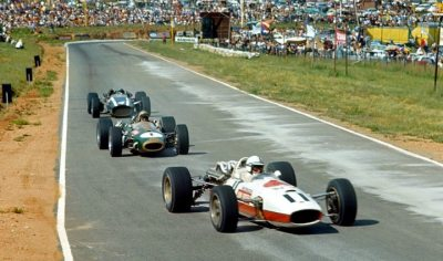 when the dust settles …John Surtees leading Jack Brabham & Pedro Rodriguez through the cement dust at the 1967 South African Grand Prix at Kyalamiit was to be Rodriguez' first win in F1 with the Cooper-Maserati T81