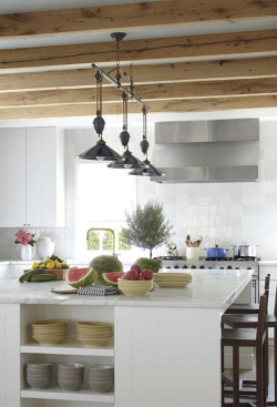 Beach house kitchen. Love the styling on the kitchen island. Photo by Laura Resen for Veranda.
