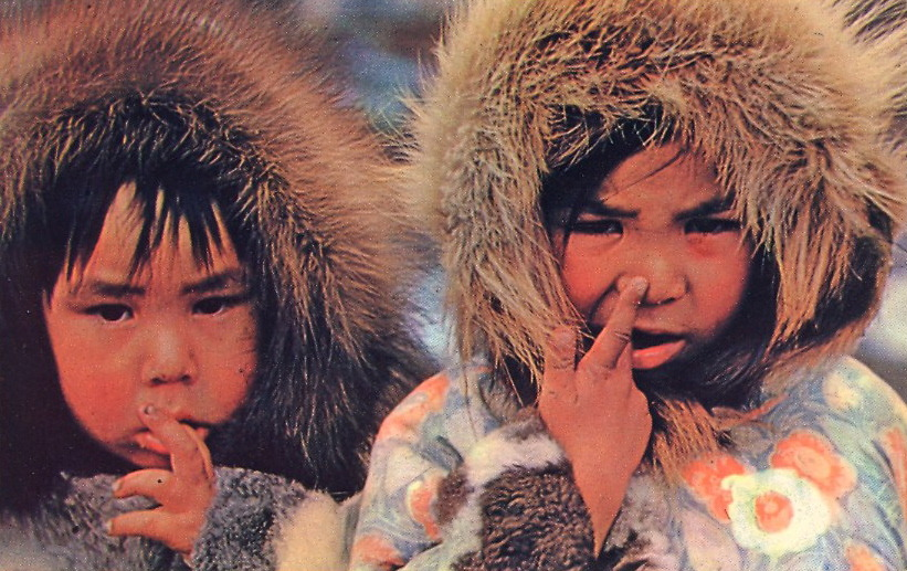 Eskimo children demonstrating the art of booger picking and eating