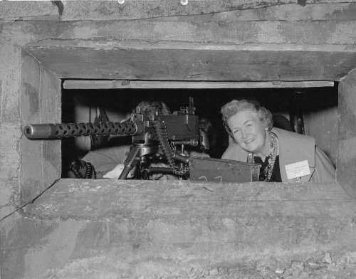 Past National President Mrs. J. Howard McKay poses in a machine gun nest during her tour of Europe.