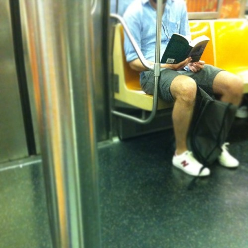 Spotted on the MTA this morning: An unsuspecting reader of Chekhov's Peasants and Other Stories, selected by Edmund Wilson. Paging the Underground New York Public Library!