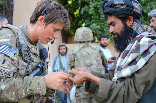Image description: An Afghan farmer shows a diseased plant to U.S. Army 1st Lt. Tara Robertson, a Minnesota Army National Guardsman serving with the Zabul Agribusiness Development Team in Zabul province, Afghanistan. The team features Minnesotan citizen-soldiers with expertise in agribusiness, such as veterinarians, hydrologists, and livestock specialists. Image by Lt. Col. Daniel Bohmer, courtesy of the Department of Defense.