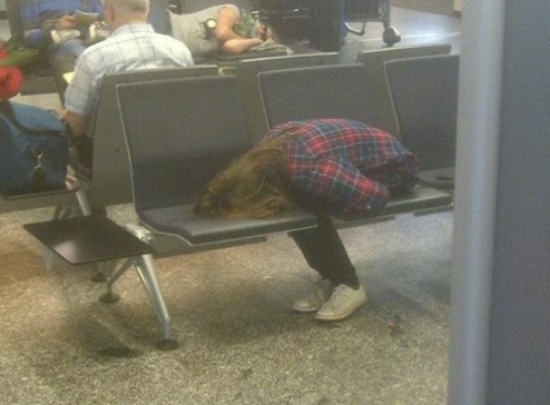 Girl Sleeping Strangely in Airport Come, rest your face where a thousand butts have been.