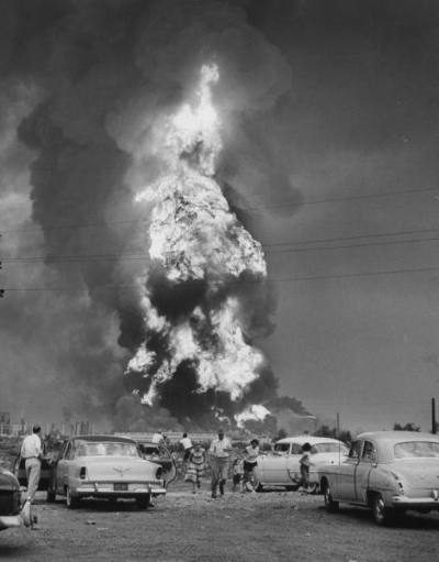 People running from an explosion at the Whiting Oil Refinery ( the largest refinery in the midwest, just outside the Chicago city limits on the south shore), 1955, Chicago. Wallace Kirkland
