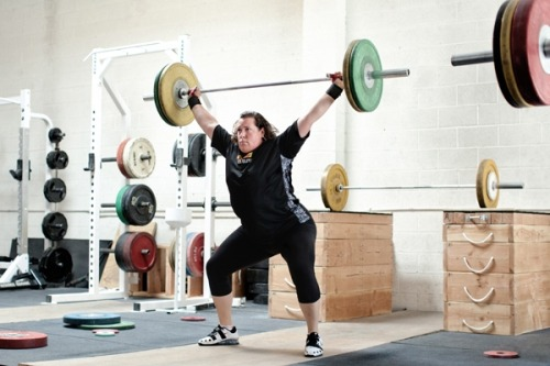"heyfatchick:   Olympian Raises the Bar for Plus-Sized Women  In this week's issue of TIME, we profile Sarah Robles, the top-ranked female Olympic weightlifter in the U.S. (The story is available on newsstands June 1, and to TIME subscribers here). As we write in the piece, Robles, who is 5 ft. 10 in. and weighs 275 pounds, ""is chasing much more than a medal in London. She's on a mission to change how people perceive larger women – and how larger women and girls perceive themselves."" When we think of Olympic bodies, we tend to picture ripped runners, or a swimmer with a six-pack. Robles doesn't fit that mold. But the Olympic stage is a chance for her to show young women that in some sports, size can be an advantage. Growing up, Robles was always the biggest kid in the class, and often bigger than her teachers. She was bullied: kids hit her and mooed at her. But by high school, she had found an athletic outlet, and finally felt acceptance. For girls, breaking stereotypes is more difficult. We're accustomed to seeing bulky guys playing football. Robles knows she should shed pounds once her competitive career is over, so she can avoid long-term health risks. But for now, she's loving lifting. ""The lifts are so rhythmic, the movements so purposeful,"" Robles says. ""I like the way it makes my body look and feel. I'm healthy on the inside now."""