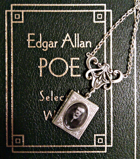 "Edgar Allan Poe book locket with solid perfume. Comes in ""Dead Writers"" which is vetiver, musk, vanilla, clove, tobacco, black tea and heliotrope. Smells like old books. Awesome. Get it here: http://ow.ly/cJ6tU"