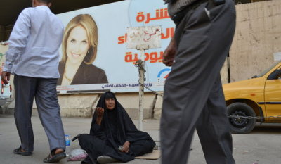 "Why Yes, That is Katie Couric on a Billboard in Baghdad The Iraqi Electricity Ministry is issuing five minute daily news bulletins about the state of the day's electricty. The unauthorized face of the campaign: Katie Couric. Via the New York Times:  At more than two dozen locations around this city, officials have posted giant billboards of Ms. Couric, billed as ""America's Sweetheart"" during her time as a host of the ""Today"" show on NBC. From high above the steamy streets, or from the side of blast walls, Ms. Couric beams out at passers-by in an advertisement for a daily news bulletin about electricity that is produced by the government and is shown on 11 satellite television channels. ""It doesn't give me hope about electricity, but I like to see her beautiful face,"" Habib Harbi, who sells watermelon in the summer and sweets in the winter, said as he looked across the street at the billboard from his fruit stand… ""We were looking for a bright and optimistic face that inspires the people to imagine a better future for electricity,"" said Musaab al-Mudarrs, the spokesman for the Electricity Ministry, who said designers had plucked Ms. Couric's image from the Internet… Mr. Mudarrs said the face of an American woman was sought for the campaign because showcasing an Iraqi woman would violate cultural taboos. And Ms. Couric, he said, was dressed appropriately in the picture — she was wearing a brown Max Mara blazer — and was the right age. ""We didn't want someone to be very old or very young, and she was in the middle,"" he said. Mr. Mudarrs did say he was a bit worried that ""when she finds out, maybe she will file a lawsuit against us.""  Katie Couric: Not too old, not too young and dressed just right. Couric tells the Times there will be no lawsuits but the billboards are ""bizarre and slightly amusing."" New York Times, Putting a Megawatt Smile on a Simmering Problem."