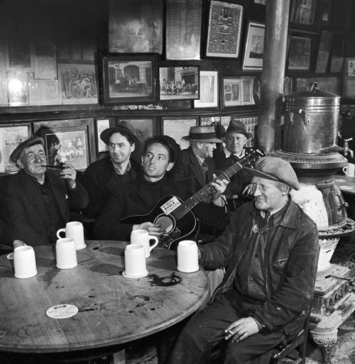 life:  Not originally published in LIFE: Woody Guthrie at McSorley's Old Ale House, still standing today in the East Village, New York City, 1943. See more photos of Woody Guthrie here.  So good. For so many reasons.